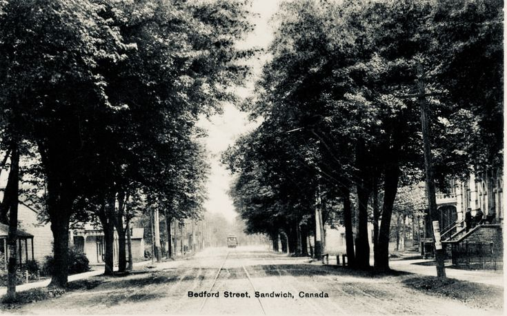 Circa 1911 Old Sandwich Town on Sandwich St. (Formerly Bedford St) looking towards Mill St.  The Municipal Court house is on the right where guards/police are standing on the stoop.