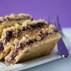 This recipe is quick and easy, but the resulting oatmeal bar cookies topped with raspberry jam taste so decadent. One reviewer suggested using lemon juice in place of water and a few splashes of milk, 1/2 & 1/2, etc with the cake mix. Great reviews!