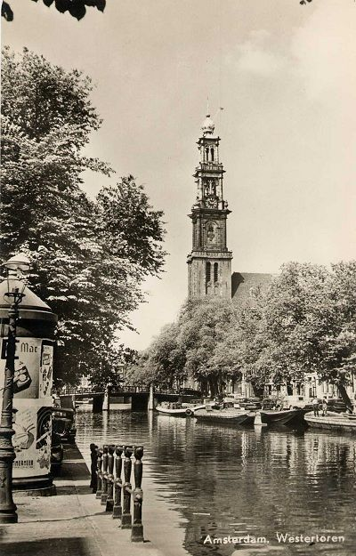"1950's. View on the Westerkerk from the Prinsengracht. On the left a ""peperbus"". The ""pepperbus"" is an electricity transformer hut (""pepper""). The outside of the transformer is rented out as advertising space to generate extra income for the electricity company. #amsterdam #1950"