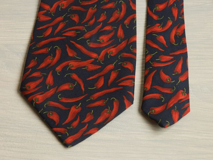 Novelty printed silk mens necktie with peppers.   St. Michael for Marks&Spenser 100% Silk Color: red peppers on a dark blue (almost black) background  Pre-owned vintage tie with no defects  Size: Width - 9,5 cm / 3,7 in. Length - 147 cm / 57,9 in   *** Shipping Policy ***  Worldwide delivery is provided Shipping within 1-3 Business days Default carrier: Ukrainian National Post (UkrPost) Way of delivery: airmail Track-number will be provided for every shipping Express-delivery (T...
