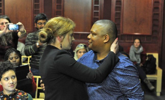 Fired SABC journalists Suna Venter and Ivor Price hug each other during their case against the corporation at the Labour Court on July 21, 2016 in Johannesburg, South Africa. (Photo by Gallo Images / Beeld / Felix Dlangamandla)