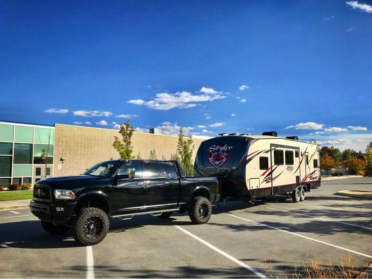 Gorgeous blacked out lifted cummins diesel ram 2500 pulling/ towing travel trailer