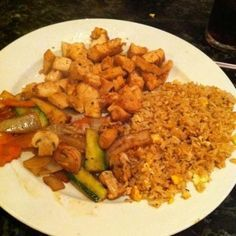 Hibachi Chicken and Fried Rice from Food.com:   								This is a recipe for a full hibachi style meal.  It includes the chicken, veggies, fried rice, and bean sprouts. My husband and I put together a combination of recipes that we found on the interenet and created this one.  It is very good for a night in, when you do not wish to pay the expensive prices at the Japanese steak house.