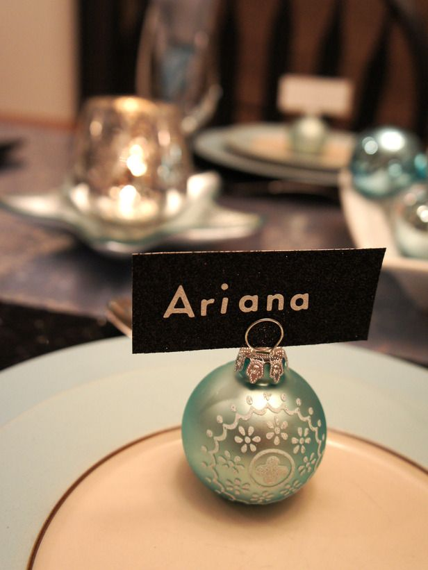 Simple Settings: Designer Katrina Giles used robin's egg blue ornament balls as name card holders for each place setting. The name cards are made of black glitter yardstick and silver letter stickers and can be used from season to season.