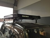Mitsubishi Pajero with a Yakima roof rack and extended Megawarrior.  #hitchngear