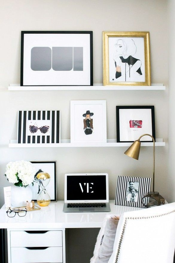 Leaning, feminine art in work space with various frames: