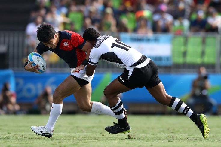 Shohei Toyoshima of Japan is tackled by Samisoni Viriviri of Fiji during the Men's Rugby Sevens semi final match between Fiji and Japan on Day 6 of the Rio 2016 Olympics at Deodoro Stadium on August 11, 2016 in Rio de Janeiro, Brazil.
