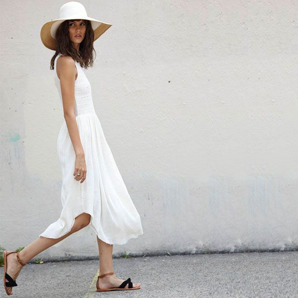 Floppy hat and cool white dress - we're guessing she's in Provence! www.provencedays.com