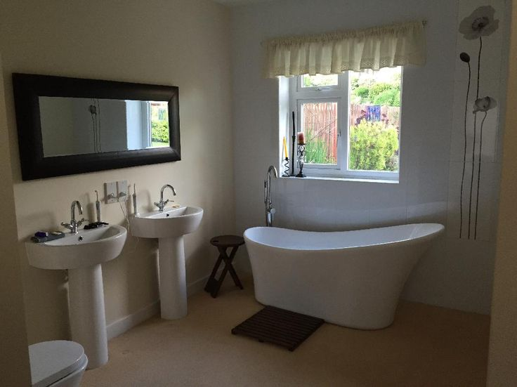 antony from cleckheaton uses a lovely bath and twin basins to create a modern style