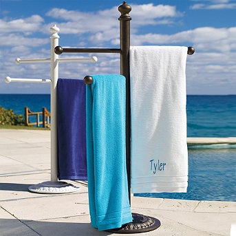 Cast-Aluminum Towel Stand:  This Cast-Aluminum Towel Stand is decorative and functional — it will serve poolside duty for seasons to come. Great for hanging towels or wet swimsuits. Blends handsomely with today's finest outdoor furnishings.