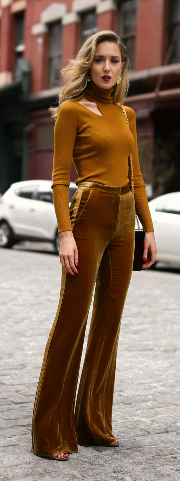 Marigold cut out long sleeve turtleneck, velvet gold tuxedo striped wide leg trousers, multi jewel toned handbag and sculptural gold earrings {ALC, Tory Burch, Veronica Beard, Amber Sceats}