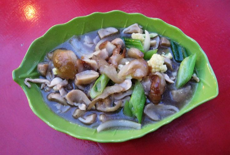Haisom Cah Jamur or Teripang Cah Jamur, Indonesian Chinese stir fried sea cucumber with mushroom dish. Served in Chinese Indonesian restaurant in Grogol, West Jakarta, Indonesia.