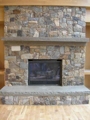 stone wall with woodstove and bluestone mantel and hearth | Custom Fireplace Mantels - Hearths - Corbels - Arches