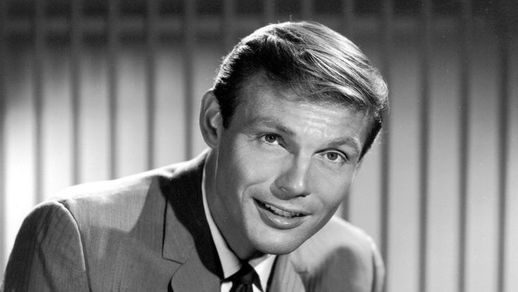 Adam West (September 19, 1928 – June 9, 2017) was an American actor. Widely known for his role as Batman in the 1960s ABC series of the same name & its 1966 theatrical feature film, his career spanned 7 decades. West began acting in films in the 1950s. He played opposite Chuck Connors in Geronimo (1962) & The Three Stooges in The Outlaws Is Coming (1965). He also appeared in the science fiction film Robinson Crusoe on Mars (1964), & performed voice work on The Fairly OddParents & The…