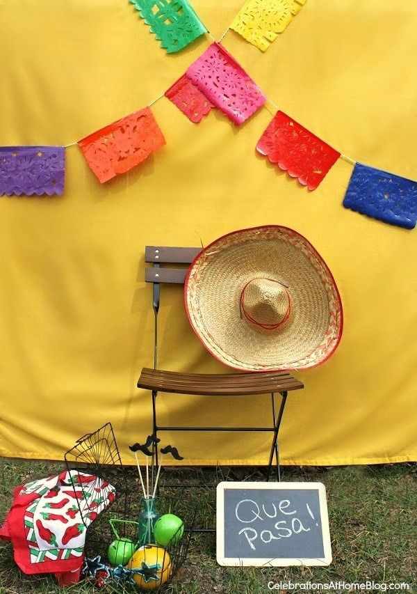 a festive cinco de mayo party isn't complete without a photo area! Create a backdrop like this and see more party tips here...