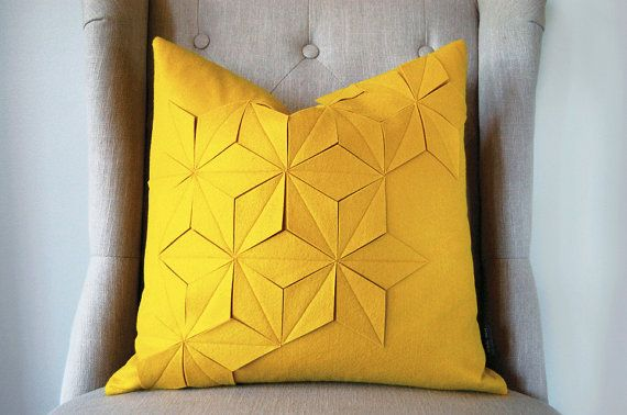 Materials and Measurements ----    * The front and back of the pillow is a golden yellow wool & acrylic blend felt fabric; very soft touch!    *