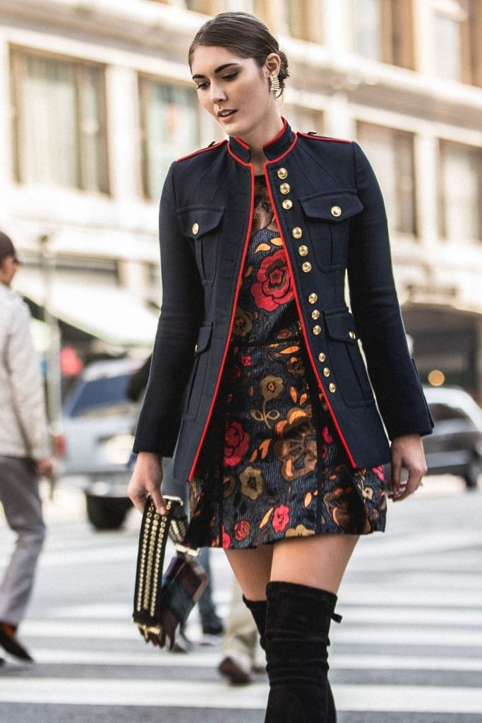 Punctuated with gold buttons, pockets and piping, military-inspired toppers have been huge on the fall runways. Wear one with a printed mini and over-the-knee boots for the perfect combination of masculine accents and feminine polish.