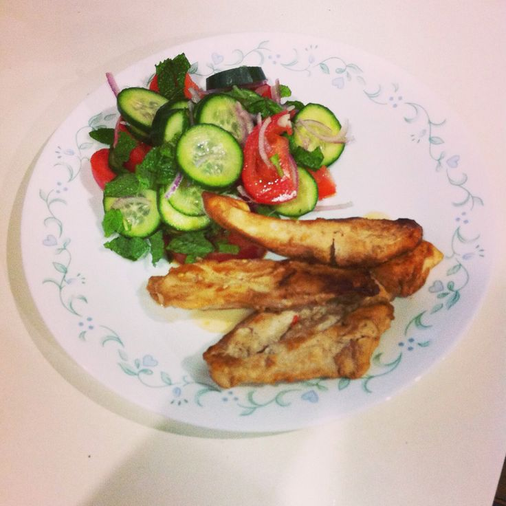 baked yoghurt chicken with tomato, mint and cucumber salad