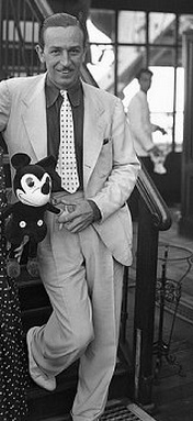 Walt Disney standing with Mickey Mouse doll 1935