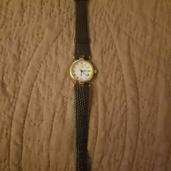Mustde Cartier ladies watch Authentic, vintage, never worn, Mustde Cartier vermeil quartz ladies watch with black leather band and gold accents.  Swiss m.t.  Measures 7 1/2in L x 1/2in W.  Appraisal attached to prove authenticity.  Will require a new battery. Cartier Accessories Watches