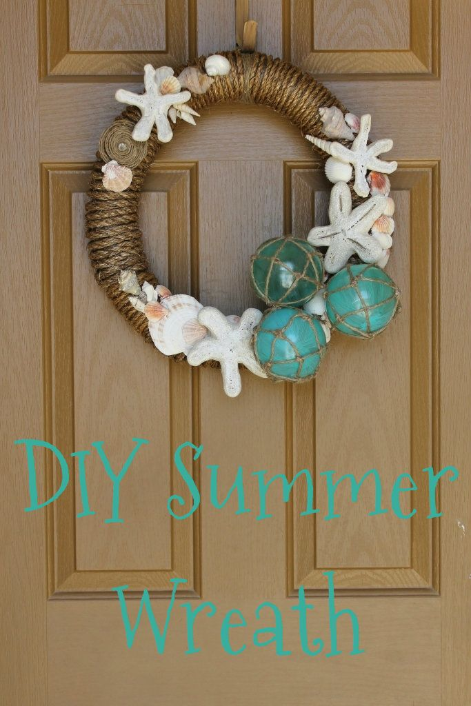 DIY Summer wreath made from a foam pool noodle, rope, seashells, star fish and faux fishing floats