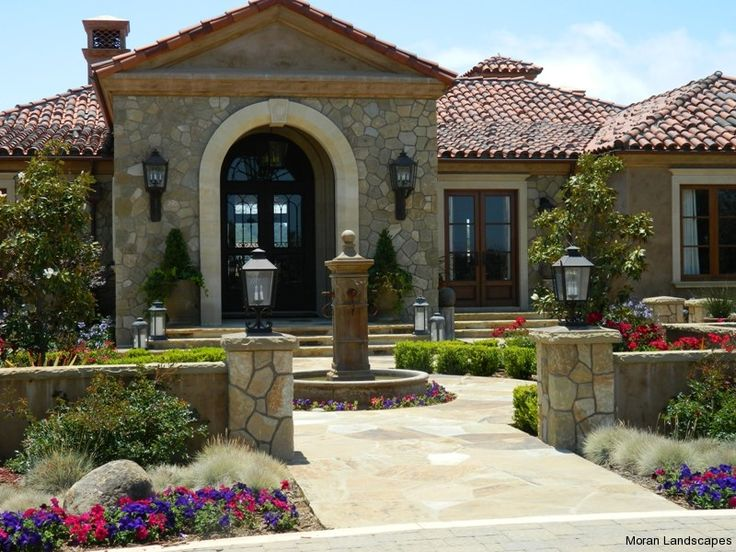 Spanish style front entry courtyard gardening for Courtyard entry house plans