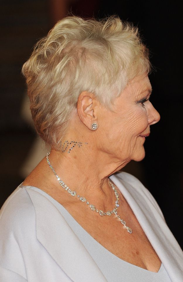 Judi Dench's jewelry~Notice the 007 on her neck!