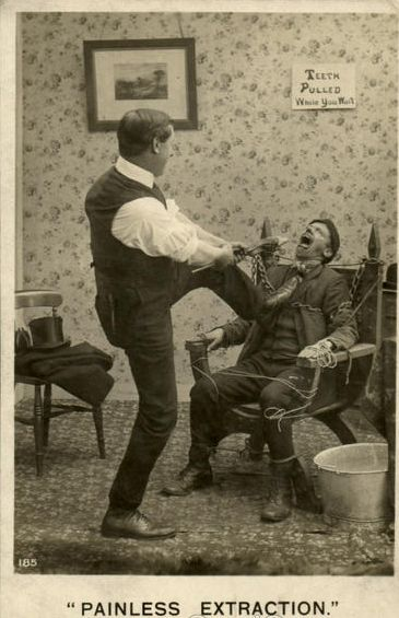 """This photo must have been a staged joke, showing a patient tied to the chair, and the dentist """"extracting"""" a tooth."""
