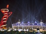 Searchlights shine over the Olympic Stadium: Fake rain may be needed