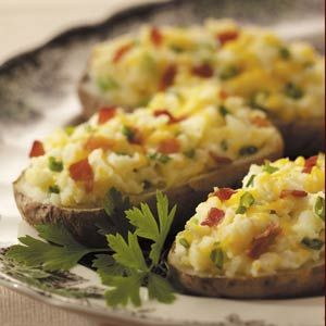 Bacon 'n' Cheese Stuffed Potatoes Recipe -Here's my creamy and rich version of twice-baked potatoes. Always a treat, they go very well with the Chicken Cordon Bleu for my holiday dinner. —Merle Dyck, Elkford, British Columbia