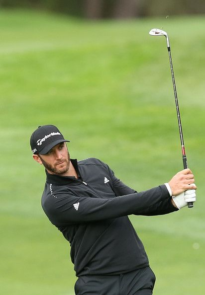 Dustin Johnson hits his second shot on the 17th hole ...