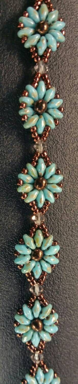 Check out this item in my Etsy shop https://www.etsy.com/listing/246676138/turquoise-super-duo-daisy-bracelet