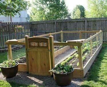 Raised & enclosed garden  [Via Organic Gardening]