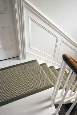 White painted stairs with a runner