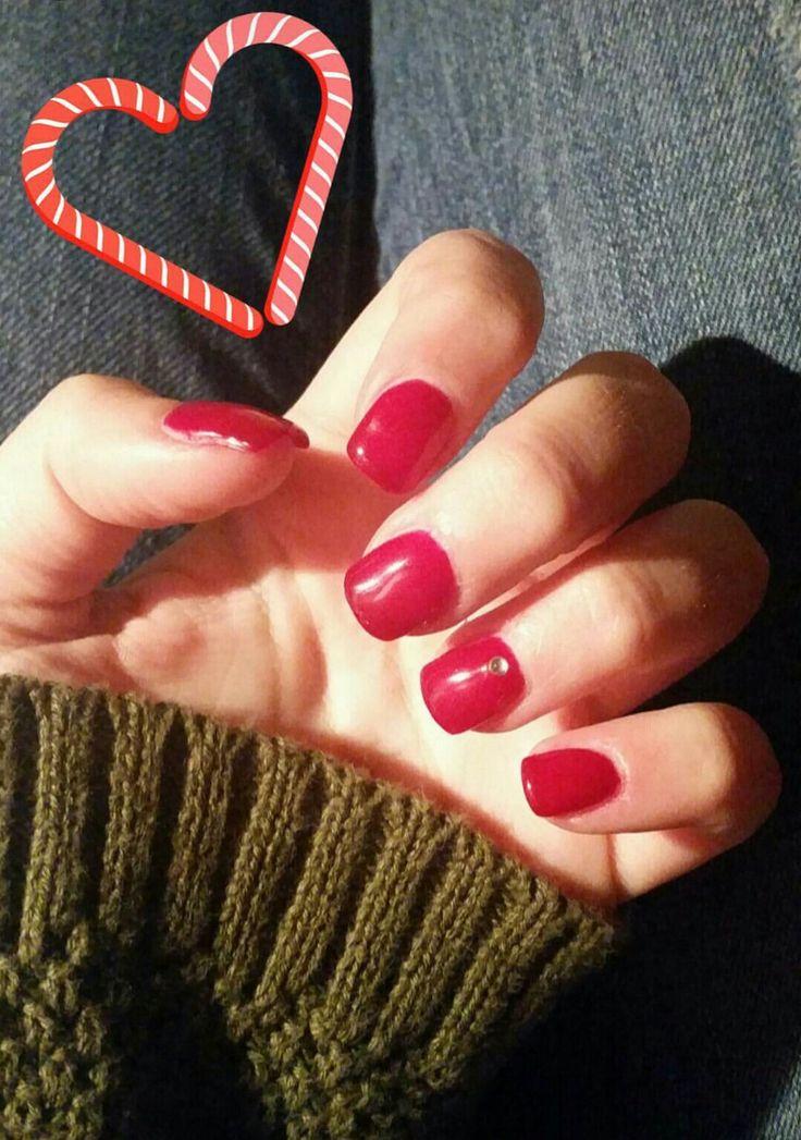 Unghie rosse natalizie con strass argento