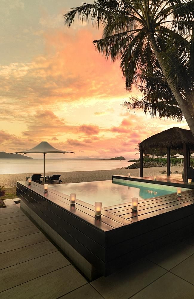 Sunset from the beach house with pool, one of the resort's most exclusive accommodation one &only Hayman Island