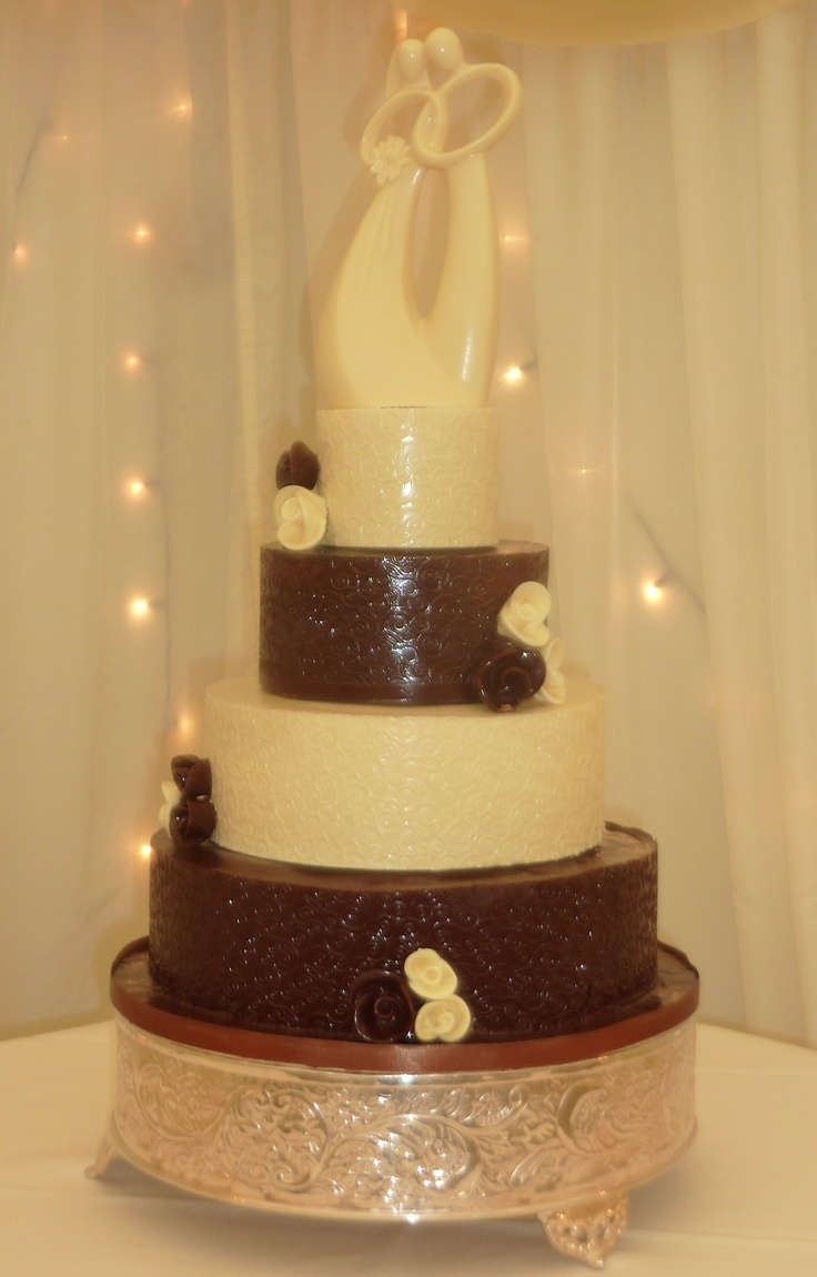 Chocolate wedding cake topped  with handcrafted solid chocolate cake topper