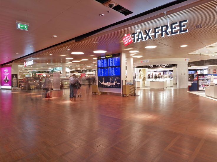The new Tax-Free Shop at Copenhagen Airport. Illuminated by hundreds of small lights, which gives a soft and comfortable glow that makes your travel and shopping experience even better.