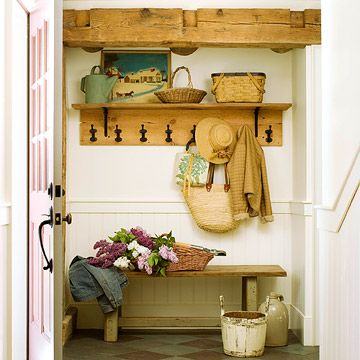 Rustic Welcome-Country charm greets visitors in this rustic entry. Re-milled pine flooring is fashioned into a coatrack with a shelf above to store a basket full of necessities and showcase a pretty painting. An old bench sits against the wall under the rack for drop-offs and seating