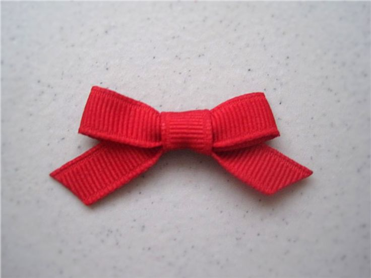 DIY little fabric bow, easy to make and/or embellish, could use as a hair bow if you glue to an alligator clip maybe? <3