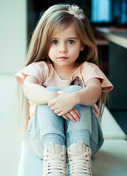 What a sweet, little girl pose. Love the headband too.