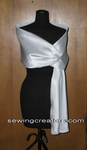 $54.95  Black-White-Satin-Pull-Thru-Shawl-Formal-Cape-Prom-Shawls-Capes-Wraps.  Approx. length is 65 inches.  The widest point of the wrap is 17 inches and is the part that pulls-thru and hangs in front.  The mid point is about 11 inches wide.  The end with the opening is approx. 9 inches.  This is a tapered wrap.  Body size will be a factor as to how long the wrap will hand down in front.