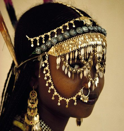 "Afar Bride, Djibouti    ""Sebera Seko, a Muslim bride from the family of the Sultan of Tadjourah, enhances her already considerable beauty with some of the most exotic gold jewelry found in the Horn of Africa. Because of her father's involvement in the dhow sea trade, she is given jewelry that comes from as far away as Saudi Arabia, Yemen, Pakistan, and India. [A dhow is an Arab type of sailing vessel.]""    photographers Carol Beckwith and Angela Fisher"