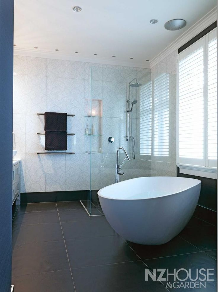 Auckland designer natalie du bois chose a wall of glistening patterned tiles to add extra sparkle to this bathroom