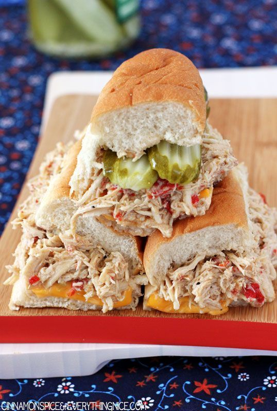 Slow-cooked, seasoned chicken breasts piled high on soft, toasted hoagie rolls with cheese, roasted red peppers, jalapeos, onions and pickles.