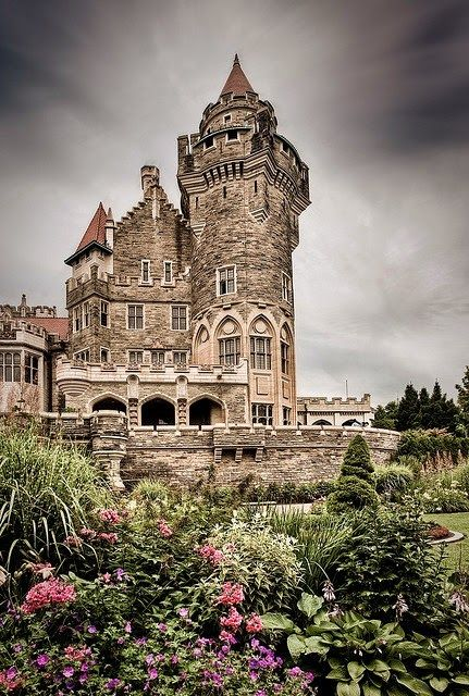 Toronto's Majestic Castle, Casa Loma, in Ontario, Canada. The former home of Canadian financier, Sir Henry Pellatt. Canada's foremost castle complete with decorated suites, secret passages, an 800 foot underground tunnel, towers, stables and beautiful 5 acres estate gardens, all in a 98 room castle.