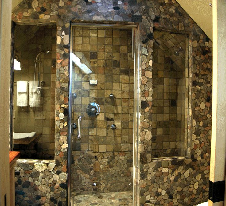 An indoor shower, that feels like an outdoor shower. River rock stones and tiles create this unique shower for a mountain home, lake house or cabin.