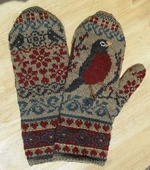 These mittens are knit with only 2 colours at a time. The third colour is added later using duplicate stitch.