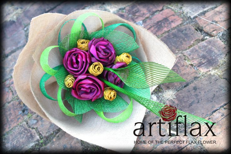 Pink and yellow flax flowers surrounded with green Hapene Flax, wrapped with hessian.