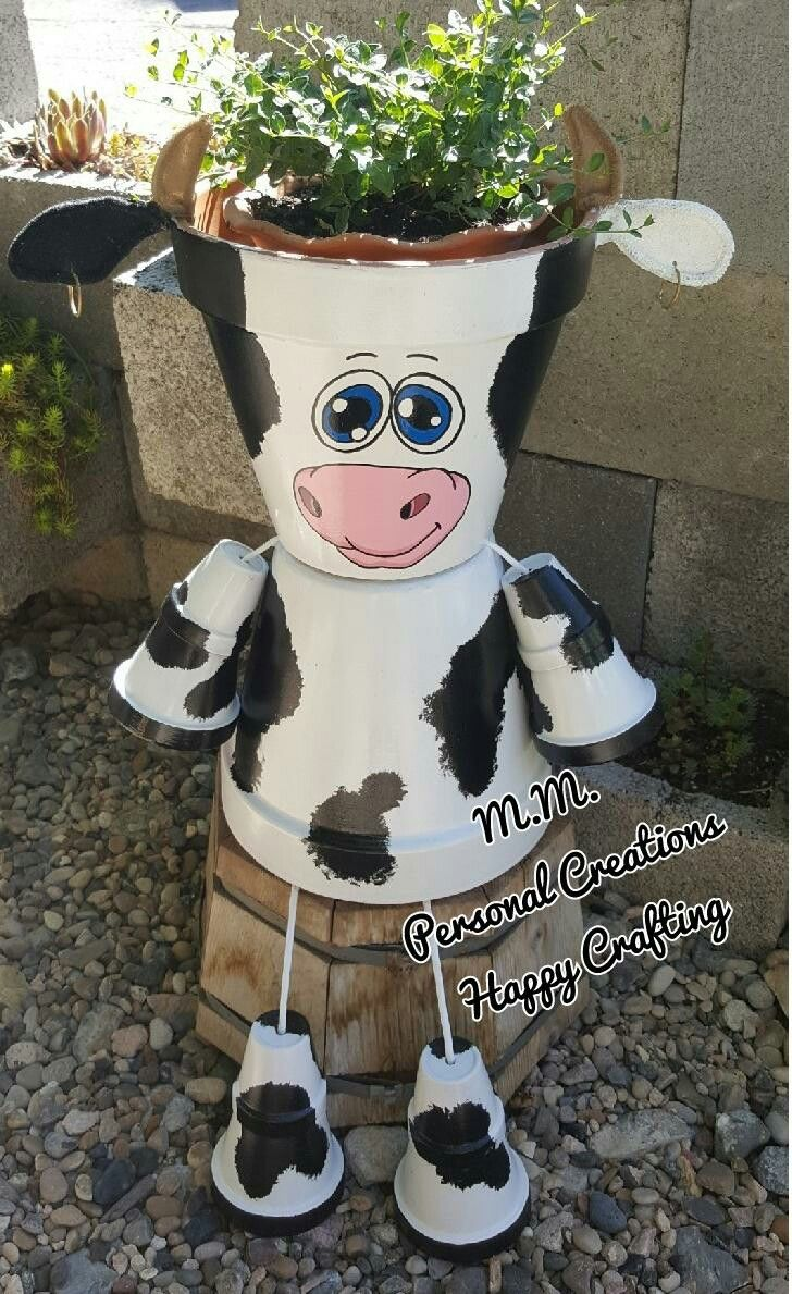 Made a new cow this year. Last year's had an accident. Never leave any clay pot animal creations outside in the winter. Oops